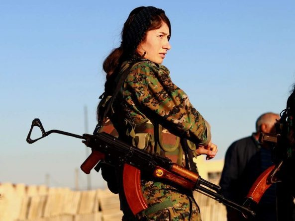 As Kurdish fighters move on last Isis-controlled town in Syria, Turkey threatens attack