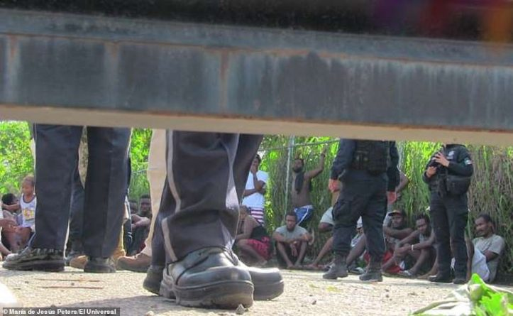 15290286-7184639-A_group_of_migrants_pictured_sit_on_the_ground_inside_the_courty-a-8_1561579915427.jpg