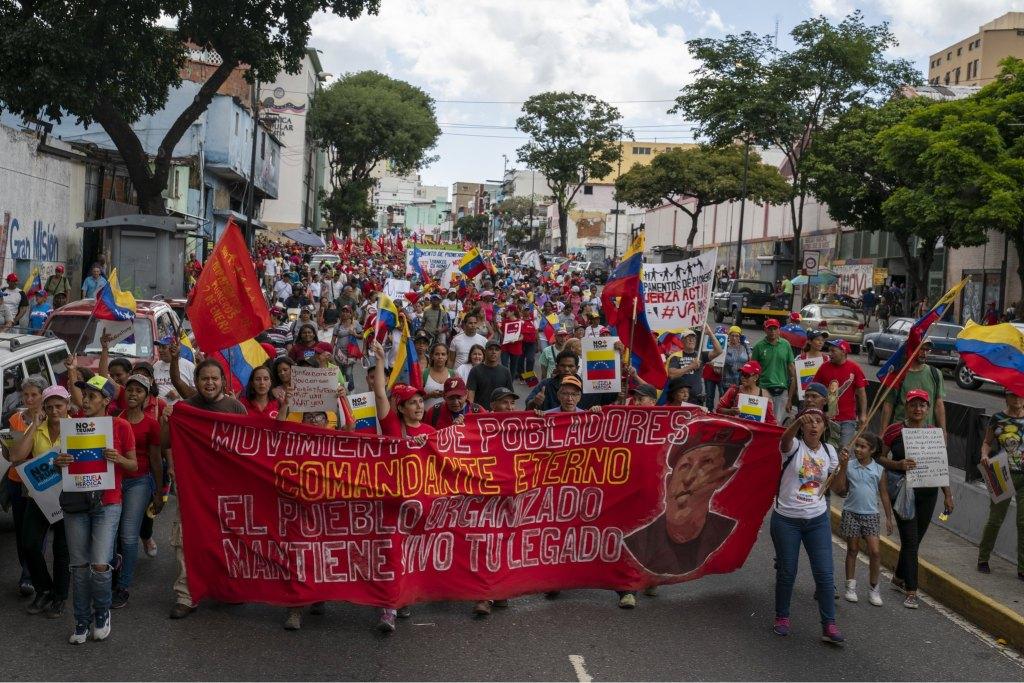 Venezuela-no-more-Trump-march-Chavez-banner.jpg