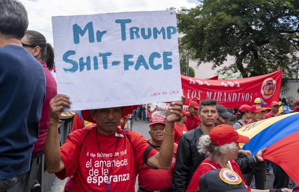 Venezuela-no-more-Trump-march-shit-face.jpg