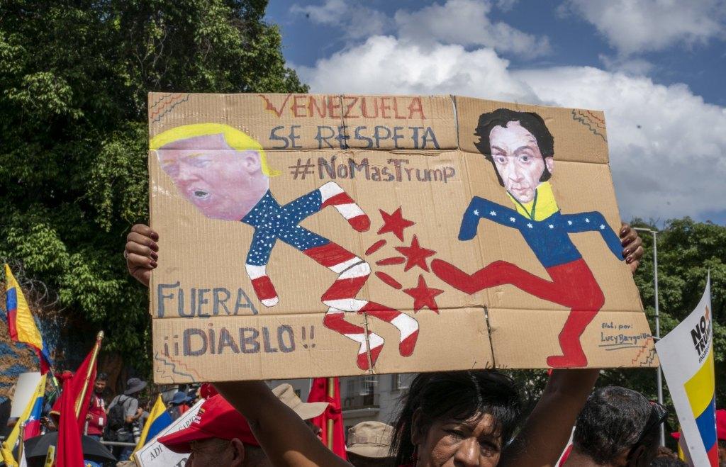 Venezuela-no-more-Trump-protest-Bolivar-kicking.jpg