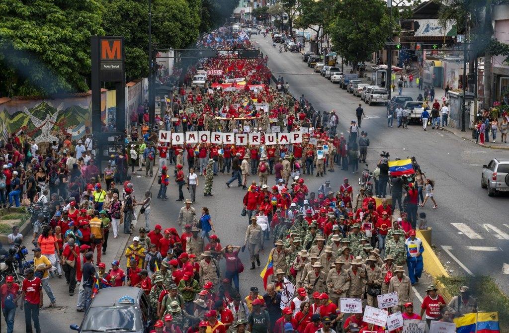 Venezuela-no-more-Trump-protest-signs-fence.jpg