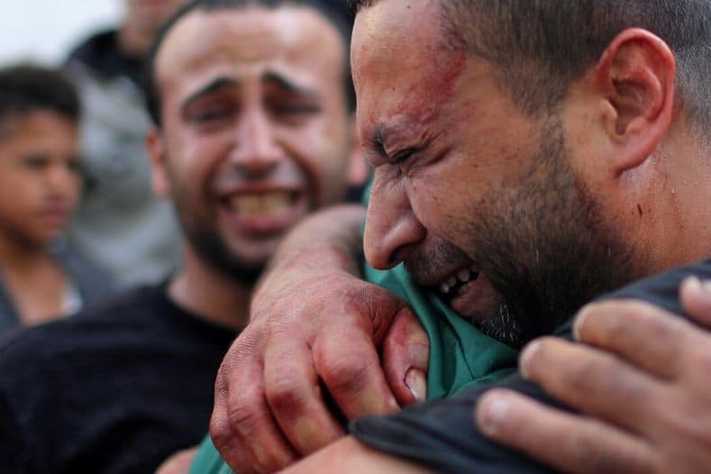 a_palestinian_manx_stained_with_the_blood_of_his_relativex_is_comforted_as_he_reacts_at_shifa_hospital_in_gaza_city_november_13x_2019_1