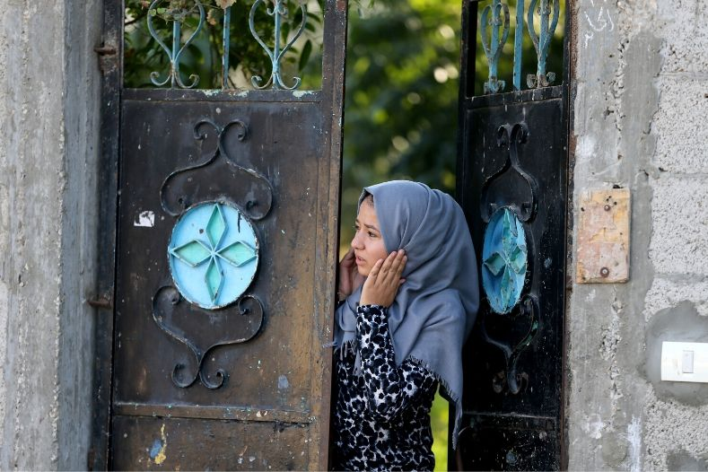 a_palestinian_woman_reacts_as_she_looks_out_of_her_home_in_the_southern_gaza_strip_november_12x_2019_