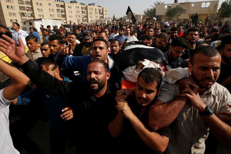 mourners_carry_the_body_of_palestinian_islamic_jihad_militant_abdullah_al-belbasi_during_his_funeral_in_the_northern_gaza_strip_november_13x_2019_