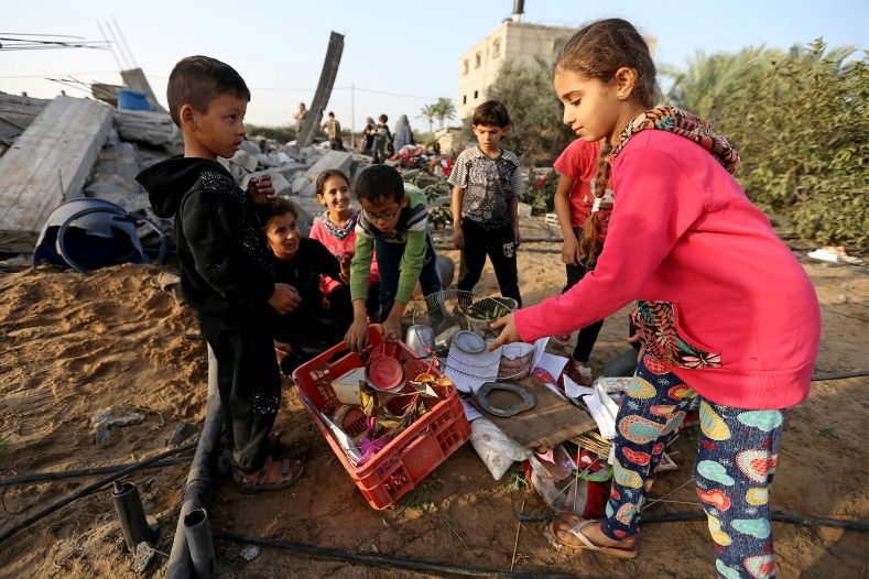 palestinian_children_collect_objects_from_a_house_destroyed_in_an_israeli_air_strike_in_the_southern_gaza_strip_november_13x_2019_