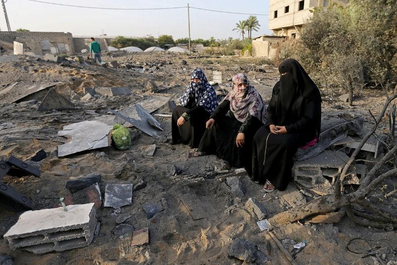 palestinian_women_sit_near_the_remains_of_a_house_destroyed_in_an_israeli_air_strike_in_the_southern_gaza_strip_november_13x_2019_