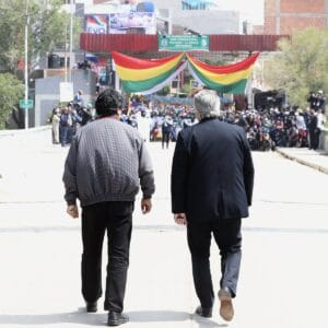 Alberto Fernandez and Evo Morales walking to the border line with Bolivia during Evo's return after one year in exile.