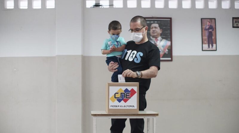 Jorge Arreaza voting with his son during 2020 Venezuelan Parliamentary Elections
