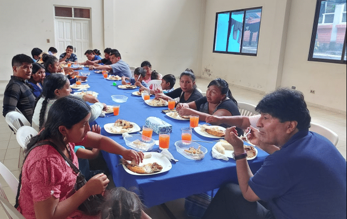 evo eating with relatives of sacaba massacre on december 24th 2020