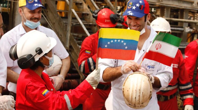 Iranian sailors greated by Venezuelan oil workers.