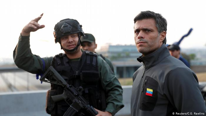Featured image: Leopoldo Lopez leading a coup d'etat in April 2019, now living like royalty in Spain. File photo.