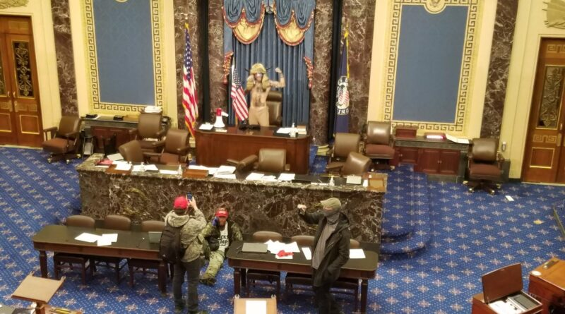 Featured image: File photo. Trump supporters took control of the Congress floor after storming the Capitol with police help. Q-anon