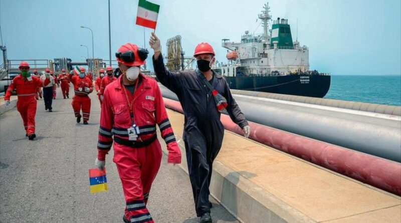Featured image: A Venezuelan worker waves an Iranian flag celebrating the arrival of the Iranian oil tanker Fortune at a Venezuelan refinery, May 25, 2020 (Photo: AFP).