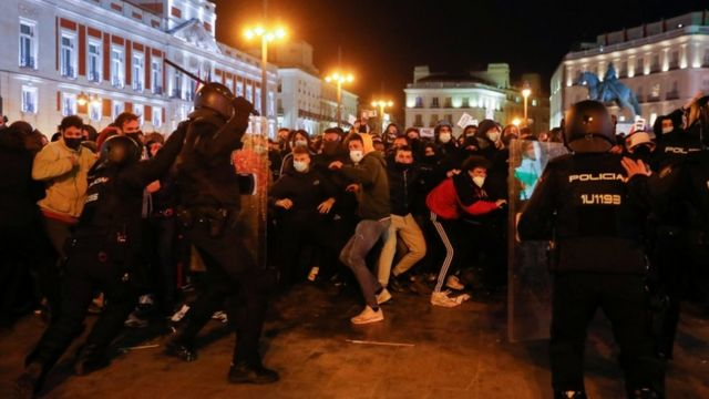 Featured image: Police excessive use of force has ignited violence in some protests demanding Pablo Hasel release. Photo courtesy of Getty Images.