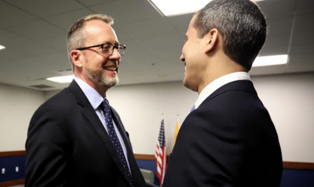 Story and former deputy Guaido during a 2020 meeting. File photo.