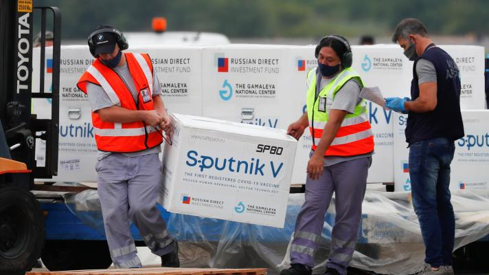 Featured image: Men unload the third batch of the Sputnik V vaccine that arrived in Buenos Aires on January 28. File photo by AP.