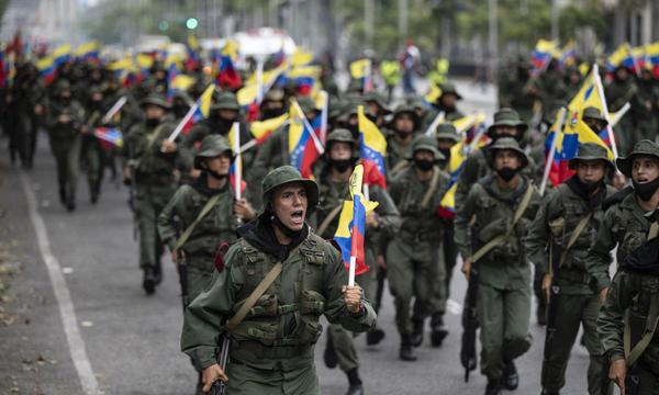 Military units and the Bolivarian National Guard of Venezuela participate in the military exercises called Bolivarian Shield Supreme Commander Hugo Rafael Chávez Frías 2021, in Caracas on March 5, 2021. (Photo by Yuri CORTEZ / AFP).
