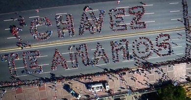 Featured image: Human sign made by 2,500 Venezuelan youths in 2013, a few days after Hugo Chavez passing. File photo.