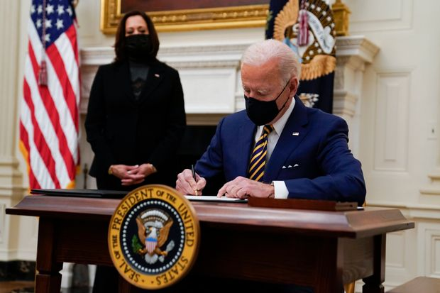 Featured image: President Biden signing executive orders last February at the White House, with Vice President Kamala Harris. Photo: Evan Vucci/Associated Press