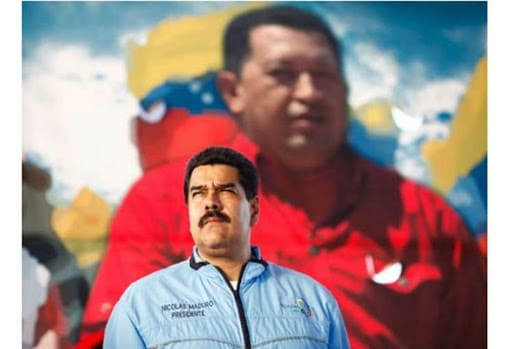 Featured image: President Nicolas Maduro with a photo of Hugo Chavez in the background. File photo courtesy of RedRadioVE.
