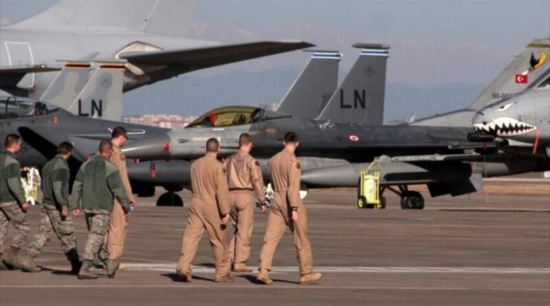 US air forces walk near military aircraft at Incirlik base in Turkey.