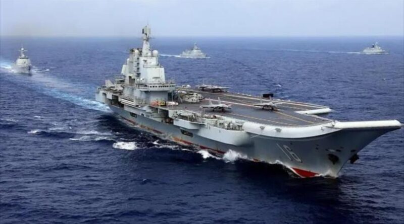 The Chinese aircraft carrier Liaoning with Chinese frigates and guided missile destroyers participating in a military exercise in the Western Pacific, April 2018.