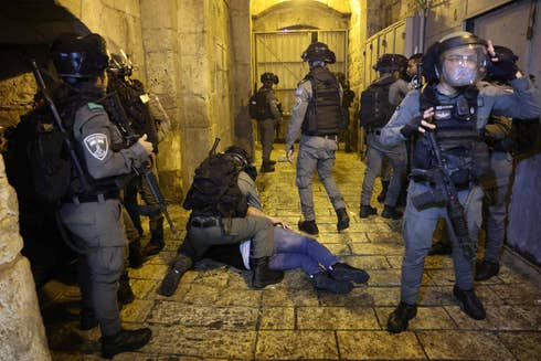 Israeli security forces detain a Palestinian protester during clashes in Jerusalem's Old City this week. Credit: Emmanuel Dunand/AFP.
