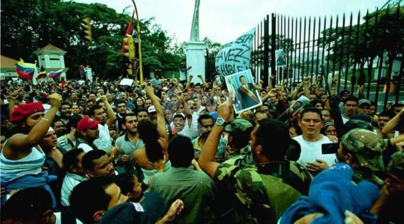 Featured image: Venezuelan Chavistas in front of Miraflores Palace demanding the return of President Chavez. File photo.