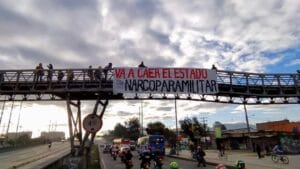 "Banner reading ""The narco-paramilitary state will fall"" hung from a bridge in Bogotá on the morning of April 28. Photo: Congreso de los Pueblos"