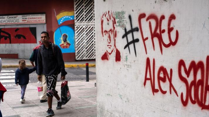 Featured image: Dozens of street paintings like the one in the photo have covered Caracas in recent months with the caption #FreeAlexSaab. File photo.