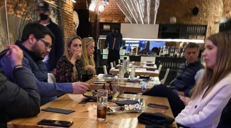 "Venezuelan fugitive, Leopoldo Lopez can be seen in this photo in the background just in front of his wife Lilian Tintori in the expensive ""La Carlota"" restaurant where they were spotted last weekend. File photo courtesy of RedRadioVE."
