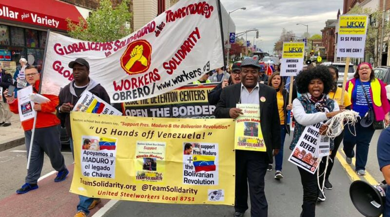 The president of the union (center), Andres Francoise, marching in Boston hanging a yellow sing in support of President Maduro. Photo courtesy of USW Local 8751.