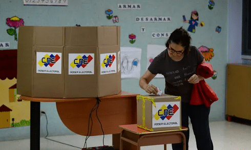 A woman votes during regional elections in Caracas on Sunday. Divisions among the opposition may hit turnout. Photograph: Federico Parra/AFP/Getty Images