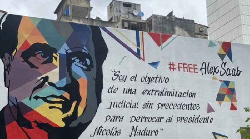 """Featured image: Street mural in Caracas with the face of Alex Saab and the caption """"I'm the object of an unprecedented legal persecution to oust President Nicolas Maduro."""" File photo."""