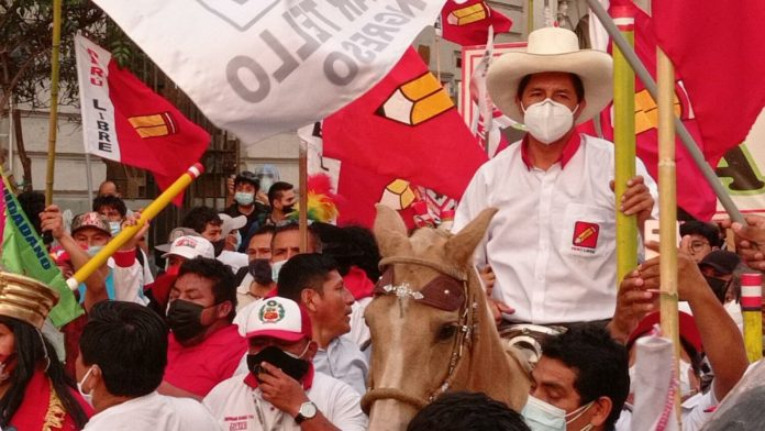 Featured image: Progressive Peruvian presidential candidate Pedro Castillo riding a horse during a political rally. File photo.