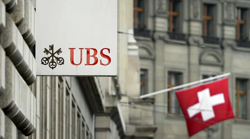 """The United Bank of Switzerland (USB) is responsible along the US government for the delay in the arrival of COVAX anti COVID-19 vaccines to Venezuela """"thanks"""" to US and European ilegal sanctions and blockade.© AFP 2021 / FABRICE COFFRINI."""