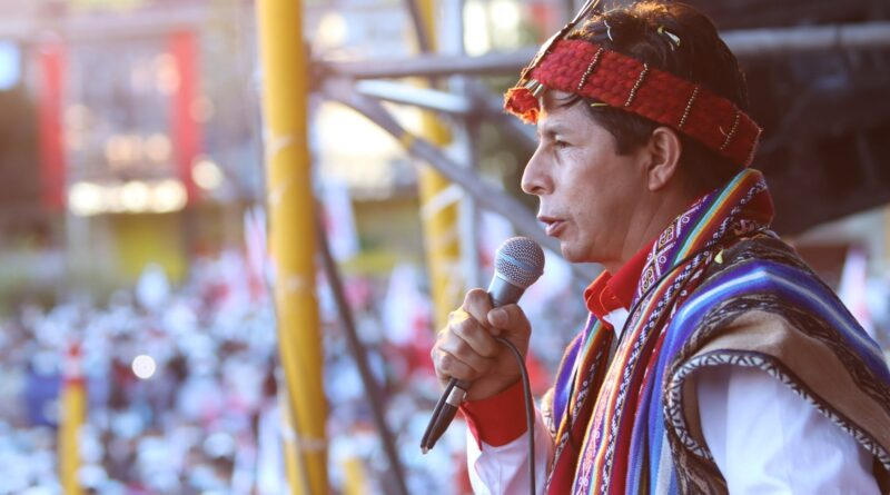 Candidate Pedro Castillo with an indigenous outfit during a political rally. File photo.