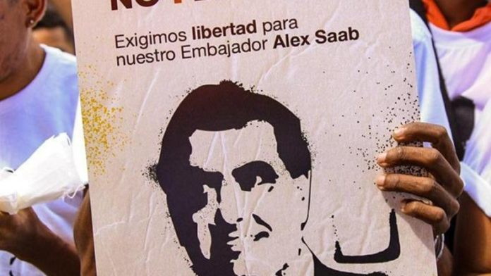 """Poster reading """"we demand freedom for our ambassador Alex Saab."""" File photo."""