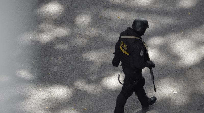 Featured image: CICPC Special Force agent walking near Plaza Madariaga in El Paraiso, Caracas on July 8, 2021. Photo by of Orinoco Tribune.