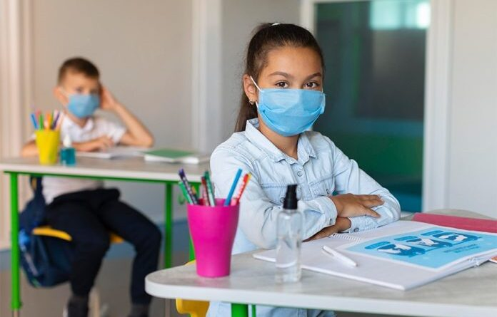 Venezuelan kids wearing face masks in a classroom. File photo.