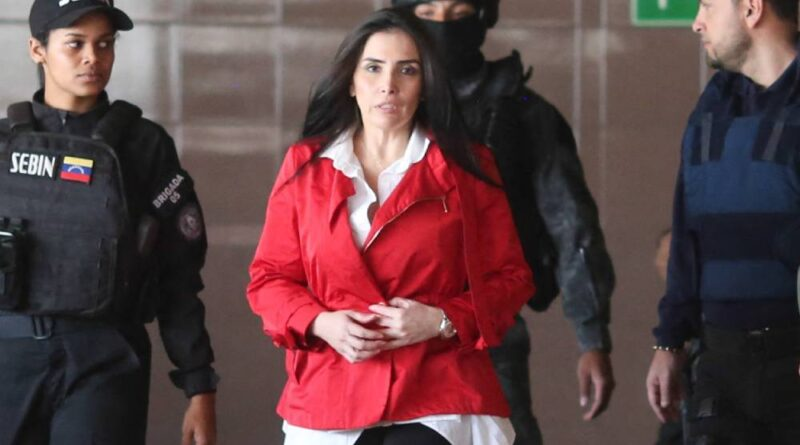 Aida Merlano being escorted by Venezuelan law enforcement officers before being presented and giving testimony to Venezuelan judicial authorities. File photo.