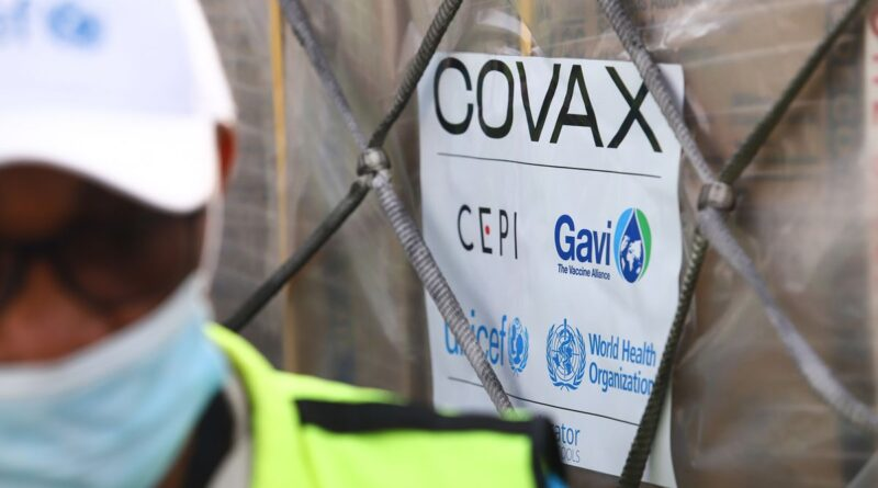 A COVAX-GAVI tag on a shipment of COVID-19 vaccines at the Kotoka International Airport in Accra. Photo by NIPAH DENNIS/AFP via Getty Images.