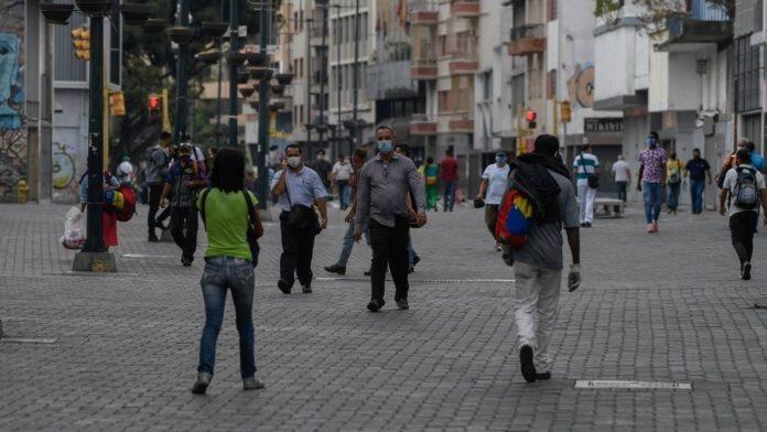 Venezuelans wearing face masks walking in a boulevard at Caracas. File photo.