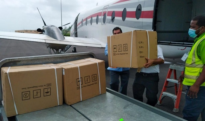 COVID-19 test kits donated by Venezuela being unloaded in the island of Dominica. Photo courtesy of Twitter / @CancilleriaVE .