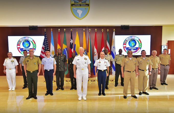 SOUTHCOM's Faller surrounded by Latin American military officers participating at the South American Defense Conference, held in Miami. Photo courtesy of Twitter / @Southcom .
