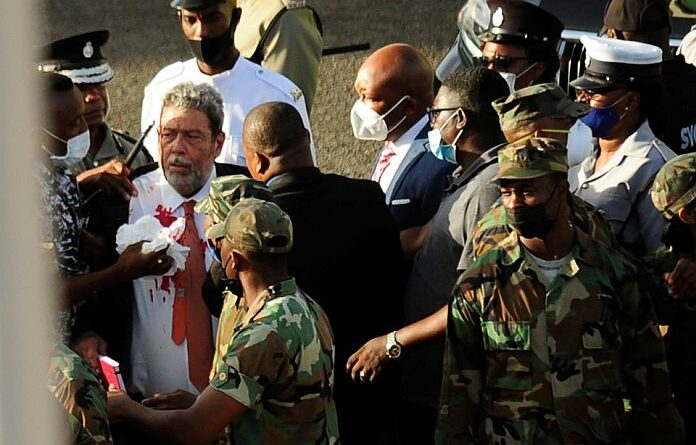 St. Vincent and the Grenadines Prime Minister Ralph Gonsalves, his shirt covered in blood, is evacuated after media reported that he was hit by a stone during a protest in Kingstown, St. Vincent and the Grenadines August 5, 2021. REUTERS/Robertson S. Henry