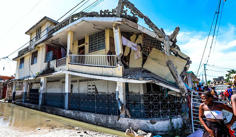 House in ruins after the most recent earthquake in Haiti. Photo courtesy of EFE.