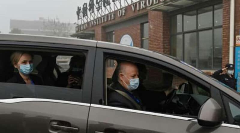 Peter Daszak, right, Thea Fischer, left, and other members of the World Health Organization team investigating the origins of the COVID-19 pandemic arrive at the Wuhan Institute of Virology in Wuhan in China's central Hubei province on Feb. 3, 2021. (Hector Retamal / AFP / Getty Images).
