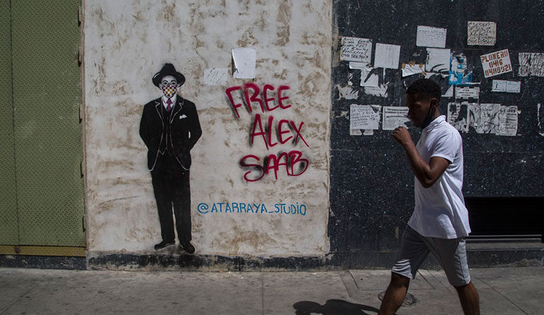 Graffiti in the streets of Caracas with the hashtag #FreeAlexSaab. Photo courtesy of Últimas Noticias.